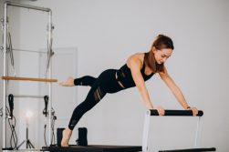 Woman doing pilates on reformer Bern Pilates